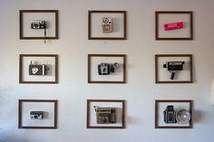 Vintage camera display in old frames