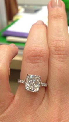 Image result for side stone elongated cushion cut diamond engagement ring thin band