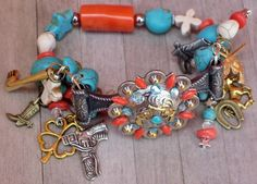 BADASS COWGIRL BRACELET Antique Silver N Gold Sixshooter Pistol Concho with Western Charms N Orange Coral Aqua Turquoise Skull N Cross Western Stretch Bracelet