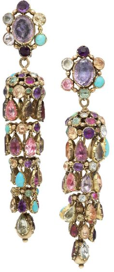 A pair of 19th century multi gem-set earrings.  Each cluster surmount suspending a highly articulated cascade drop, terminating in a beaded finial, collet-set throughout with multi-coloured circular, oval and pear-shaped gemstones, including turquoise, topaz, amethyst, emerald and garnet, all in closed-back gold settings, length 7.5cm, fitted cased by Wartski Ltd, 138 Regent Street, London, W1 and Llandudno. Via Bonhams.
