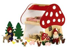 I love natural toys for babies.  This gnome dollhouse is adorable!
