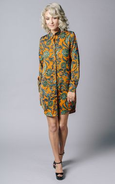Summer 70's print shirt dress.  Comes with a cute little tie belt if you want to cinch it in and show off your curves. Shop now.