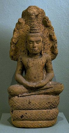 12-13th C. Buddha-to-be sat in meditation when a storm came. King Mucalinda, the Naga or Snake King lifted him up on his coils and spread his Cobra Hood over him so he would not be disturbed, Buddha in Dhyana (meditation) mudra. Thailand, period of Cambodian dominance (1022-ca.1250).