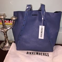 Authentic Dirk Bikkembergs shoulder bag BNWT straight from Milan. Not sold in the US. Has studs on both sides of bag. Beautiful blue. Can be buttoned across the middle or carried open. Zipper pocket and phone sleeve on the inside. Will ship with the dust bag. Dirk Bikkembergs Bags Shoulder Bags