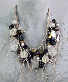 Waxed linen and beads by Teresa Goodall