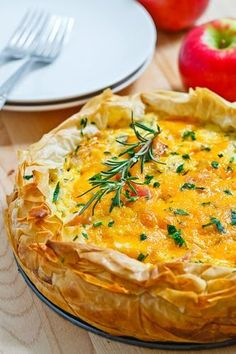 Apple and Cheddar Quiche. Pretty simple recipe. I liked the flavors of apple and cheddar and they worked well with the egg. I left out the rosemary because I'm not a fan of the spice. Should have substituted something else in, it was a little bland without it. Not as crazy about using phyllo dough. my edges got a bit burnt and it didn't do anything for me. Next time would make in regular pie crust.