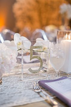 Clear glass and glitter table number