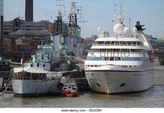 Seabourn Pride moored next to HMS Belfast - Stock Image Belfast, Boats, Pride, Stock Photos, Photography, Image, Photograph, Ships, Fotografie