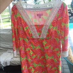 Beautiful summer Lilly Pulitzer dress only worn 1x A beautiful Lilly Pulitzer dress only worn once. Both dress and lining are 100% cotton. 3/4 sleeve. Size 2 but fits like a 4/6. Beautiful summer colors. Smoke-free home. Lilly Pulitzer Dresses Midi