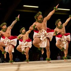 The kane from Ke Kai O Kahiki (Kumu Hula La'akea Perry; Waianae, Oahu) dance during the Kahiko portion of the #MerrieMonarch Festival competition. #mm2015 (Photo by Dennis Oda)