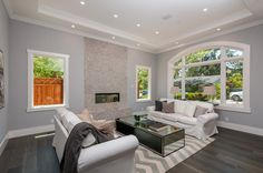 Living Room: Cool gray living space with recessed ceiling. Love that fireplace!