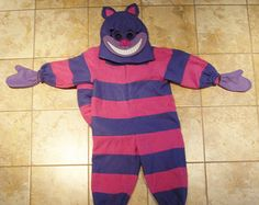 This is what the Cheshire Cat would wear. The Cheshire Cat would wear this because it shows the main characteristic of the Cheshire Cat his permanent smile on his face.  The costume looks mischievous and that's what the Cheshire Cat is.  Anyone could wear this costume. Some Cheshire Cat's costumes are only specifically made for girls or guys and both can wear this.   The costume looks mad and crazy which is an exact representation of the Cheshire Cat.