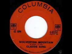 """Mid July of 1962 we were hearing the big cross-over hit from Claude King - """"Wolverton Mountain"""" playing on our radios."""
