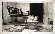 """Unknown, """"Untitled [Man with children in tub]"""" (1930s)"""