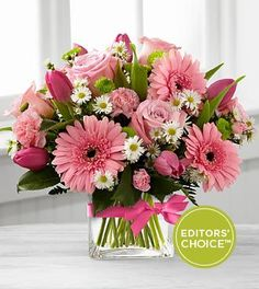 """From the Better Homes and Gardens® collection, the Blooming Vision™ Bouquet. Offer them a bouquet blooming with a """"fresh from the garden"""" appeal. Pink roses, hot pink tulips, pink mini carnations and pink gerbera daisies are accented with white Monte Casino asters and lush greens. Gorgeously arranged in a clear glass cube vase accented with a pink satin ribbon, this bouquet is a soft and graceful way to send your warmest sentiments.  Love it? We deliver nationwide! @veldkamps"""