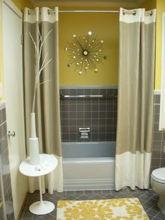 8. Create a focal point, like your shower curtain, to draw visual attention to a single place. | 15 Life Hacks For Your Tiny Bathroom