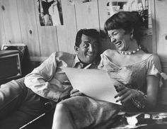 """Dean Martin rehearsing a scene with Shirley MacLaine, 1958. Along with Angie Dickinson and a handful of other actresses and dancers, MacLaine was sometimes referred to as a """"Rat Pack Mascot,"""" as she was one of the few women allowed to regularly hang out with the notoriously raucous crew of Sinatra, Martin, Lawford and company."""