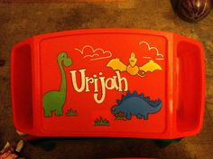 """Hand Painted Lap Tray--Dinosaur. *Hand Painted Personalized Lap Tray* Great for coloring, homework, snacks, and more. Two pockets for storage of books, markers, crayons, pens, etc. 11""""x13"""" surface area. Fits easily over most car seats and strollers. This gift is perfect for on the go or even at home! Lap Tray Colors in Lime, Pink, Purple,Orange, and Yellow . quantities may be limited, so message me with your choice of color prior to ordering to check availability. Designs include but are…"""