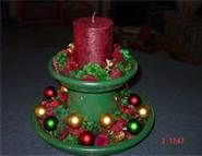 centerpiece for Christmas made out of Terra Cotta pots - I have to make this one!