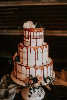You'll feel hungry after seeing this elegant drip cake | Image by Melissa Marshall Photography   #cake #cakedesign #cakeinspiration #weddingcake #weddingcakedesign #weddingcakeinspiration #cakeinspo #weddingcakeinspo #creativecake