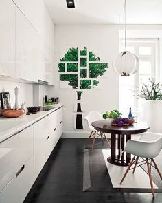 I especially love the fragmented tree piece on the kitchen wall. One word to describe this home: divine!