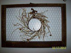 Old window frame/chicken wire, hooks and prim wreath