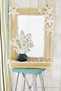 diy coastal rope mirror makeover, diy home crafts, Before it was a sweet and simple framed mirror after it has been transformed into this coastal rope mirror