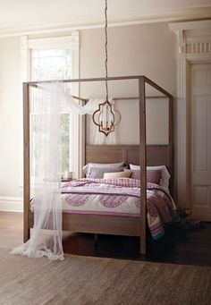 In a simple, clean-lined silhouette with a weathered gray finish, our canopy bed exudes rustic elegance. www.worldmarket.com #WorldMarket Home Decor