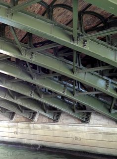 The cast iron metal girders beneath the Pont de Sully, showing the design work as you walk under the bridge.  To see more go to www.eutouring.com/images_pont_de_sully.html