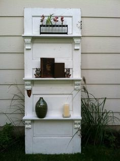 Garden shelving from a repurposed door.  On my to-do list!  http://dishfunctionaldesigns.blogspot.com/2012/01/salvaged-doors-repurposed.html #door #repurposed #salvaged #garden #outdoor #spaces #ideas