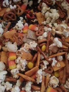 My new creation... Monster Mix - made with kettle corn, candy corn, Reese's Pieces, raisins and Cheez-Its Snack Mix (it has the pretzels, chex squares, cheez-its, rice puffs and bread slices included). Easy to make for any fall or Halloween party!