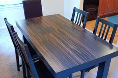 Laminate floor table top! If my table top ever gets too scratched up I'm going to try this.