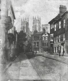 "Lop Lane is pictured from Museum Street in September 1854. The corner of the ""Red House"" can be seen on the left. Narrow Lop Lane, or Little Blake Street, led up to the minster and all the buildings on the right hand side were demolished in about 1860 to create wide Duncombe Place. Manor Houses, Ancestry, Yorkshire, United Kingdom, Medieval, Buildings, The Past, Places To Visit, September"