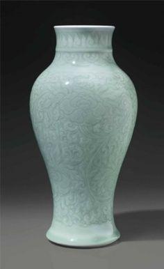 A celadon-glazed carved baluster vase, China, Qing dynasty, Kangxi period (1662-1722)