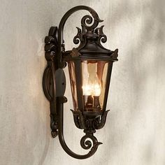 Inspired by the romantic Mediterranean, this traditional outdoor wall light adds curb appeal to a porch, patio or entryways.