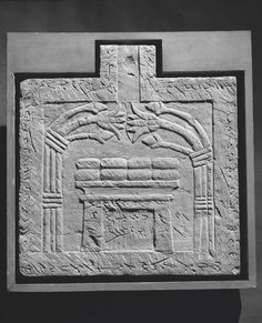 Offering table. Relief, Meroitic inscription along perimeter. A pylon in the center with a bunch of lotus flower on either side. Meroitic period. Karanog.