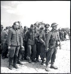 Two German officers in a group of prisoners who surrendered to Canadian troops in Courseulles, June 6th, 1944.