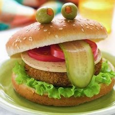 Animal Fun Food- Hamburgers just got even better! Try this cute froggy hamburger at your next barbecue! #JungleJim #animalfunfood #animalfood #snackideas #froggy