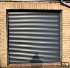 Included in your new garage door cost is expert measuring, fitting and VAT. Within our remote-controlled roller shutter garage doors price is also a guarantee. Click the link to see our insulated roller garage doors prices. Grey Garage Doors, Shutter Doors, Faux Wood Blinds, Garage Door Cost, Roller Shutters, Garage, Garage Door Colors, Doors, Shutters