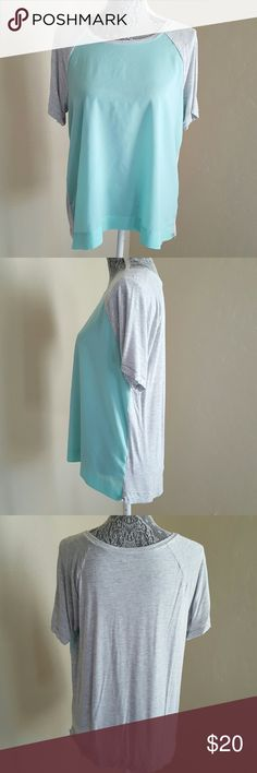 Color Block Mixed Media Top This top features short sleeves and a fun color block style. Pre-loved and in great condition. Knit is 95% rayon,  5% spandex, woven is 100% polyester, machine washable. Color is aqua and heather gray. Apt. 9 Tops Tees - Short Sleeve