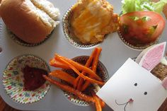 Sliders (honey wheat dinner roll, chicken breast patty with a slice of colby cheese, lettuce, tomato slice), carrot, sweet potato and potato fries, ketchup, carrot cake in a bunny envelope