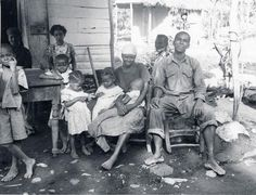 """haiti history 1940s museum quai branly A Haitian extended family gathers for a group photo. Visiting anthropologists like Mercer Cook and Haiti's very own Jean Price Mars noted that in the countryside, Haitian families kept the living traditions of their ancestors in Africa, including the """"lakou"""" system, in which various families lived in one unit. Even today, when some of our parents say 'fanmi', they don't just mean mom, dad, kids, they mean practically the whole family tree!"""