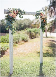 White wedding arch with flower details || The Ganeys