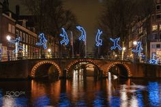 Gymnastic exercises of a light figure on a bridge - Gymnastic exercises of a light figure on a bridge Amsterdam Photo by Julia Heikens
