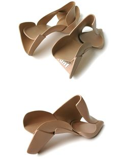 """Deconstructed shoes - sections of vegetable tanned leather, pre-formed on a variety of shoe lasts (mould that is shaped in the form of an abstracted foot), are cut and assembled to create a fractured shoe - """"Mouldedleathershoe"""" designed by Marloes ten Bhömer, 2003"""
