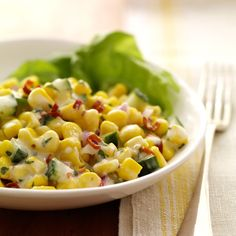 Flavorful ingredients, such as cilantro, lime juice and cumin, add Southwestern flair to corn salad.