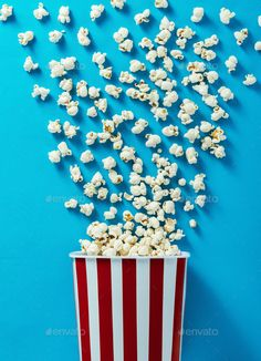 and cinema by stockasso. Popcorn explosion on blue background, cinema and entertainment concept and cinema by stockasso. Popcorn explosion on blue background, cinema and entertainment concept Food Wallpaper, Iphone Wallpaper, Popcorn Posters, Cinema Popcorn, White Popcorn, Popcorn Times, Cute Winnie The Pooh, Homemade Popcorn, Pop Corn