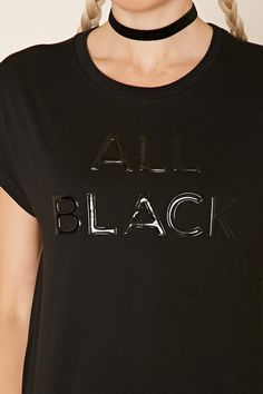 "A longline cotton-blend knit tee featuring a raised ""All Black"" graphic on the front, cuffed cap sleeves, crew neckline, and a dolphin hem."