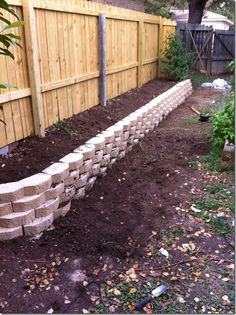 Raised bed along fence for side yard garden