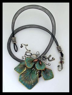 This necklace was a collaboration between Vancouver metal & wire artist Eugenia Chan (www.eugenia-c.com) and myself for a project we taught at the Feb 2011 Vancouver Polymer Clay Retreat. I made the leaves based on my Pinched Leaf tutorial (www.helenbreil.com/Tutorial_Pinched_Leaf.php and Eugenia did all the rest!